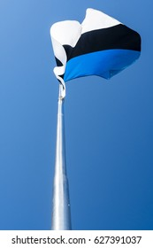 The national flag of Estonia.