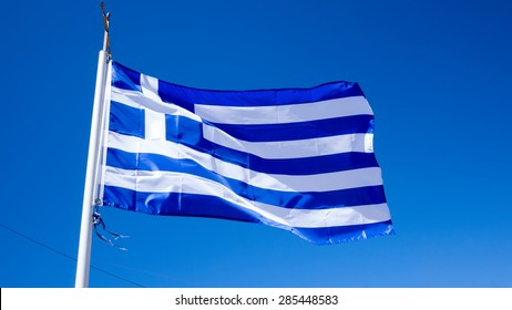 national flag of Greece against blue sky background