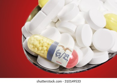 The national flag of Iowa on a capsule and pills on a spoon.(series)