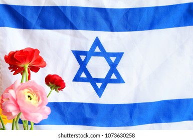 National flag of Israel and spring flowers. Independence Day