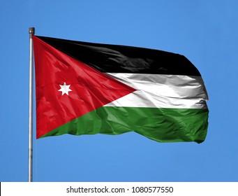 National flag of Jordan on a flagpole