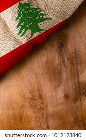 The national flag of Lebanon on a wooden surface