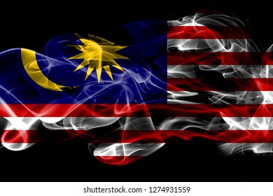 National flag of Malaysia made from colored smoke isolated on black background