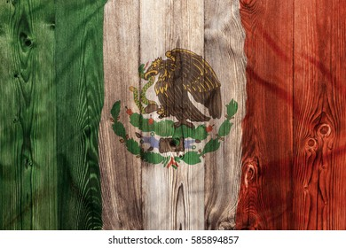 National flag of Mexico on wooden background