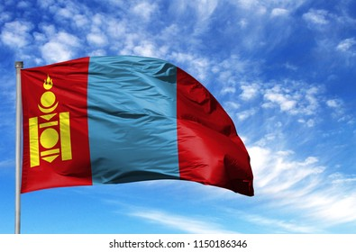 National flag of Mongolia on a flagpole in front of blue sky