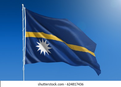 The National flag of Nauru blowing in the wind in front of a clear blue sky