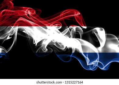 National flag of Netherlands made from colored smoke isolated on black background. Abstract silky wave background