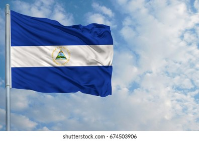 National flag of Nicaragua on a flagpole in front of blue sky.