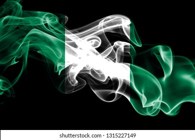 National flag of Nigeria made from colored smoke isolated on black background. Abstract silky wave background
