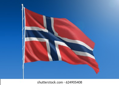 The National flag of Norway blowing in the wind in front of a clear blue sky
