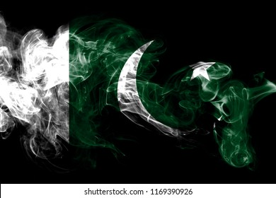 National flag of Pakistan made from colored smoke isolated on black background. Abstract silky wave background.