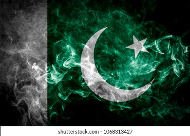 National flag of Pakistan from thick colored smoke on a black isolated background