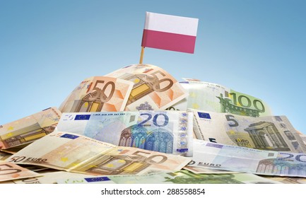 The national flag of Poland sticking in a pile of mixed european banknotes.(series)
