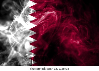 National flag of Qatar made from colored smoke isolated on black background. Abstract silky wave background.