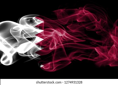 National flag of Qatar made from colored smoke isolated on black background