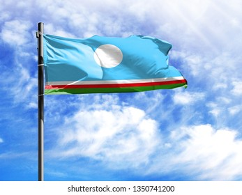 National flag of Sakha Republic on a flagpole in front of blue sky.
