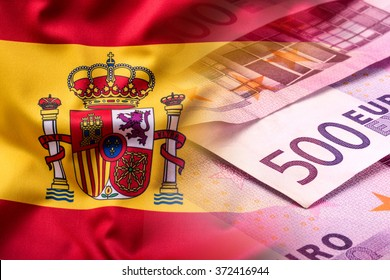 National flag of spain and euro banknotes.