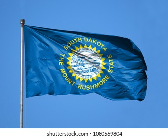 National flag State of South Dakota on a flagpole