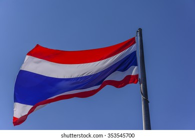 National flag of Thailand with blue sky