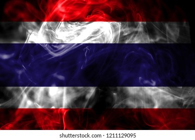 National flag of Thailand made from colored smoke isolated on black background. Abstract silky wave background.