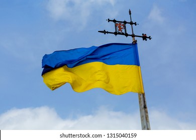 national flag of Ukraine - blue and yellow on cloudy sky background