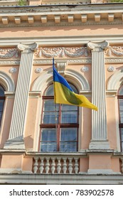 National flag of Ukraine in a building window