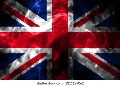 National flag of United Kingdom made from colored smoke isolated on black background. Abstract silky wave background.