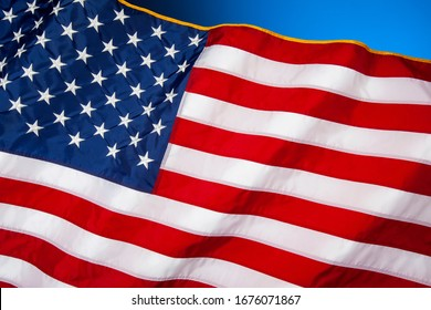 National flag of the United States of America.  The 50 stars represent the 50 states and the 13 stripes represent the thirteen British colonies that declared independence from Great Britain.