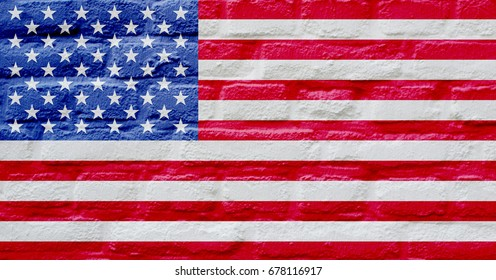 The national flag of the United States of America painted over brick wall background