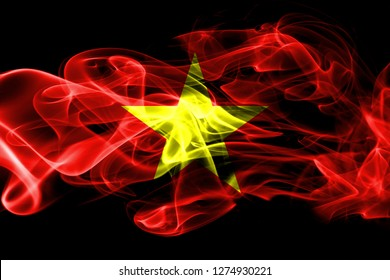 National flag of Vietnam made from colored smoke isolated on black background