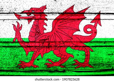 National flag of Wales, abbreviated with gb-wls; a realistic 3d image of the national symbol from an independent country painted on a wooden wall