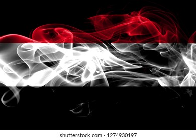 National flag of Yemen made from colored smoke isolated on black background