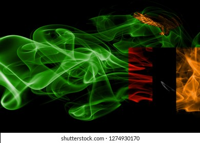 National flag of Zambia made from colored smoke isolated on black background