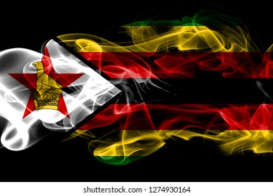 National flag of Zimbabwe made from colored smoke isolated on black background