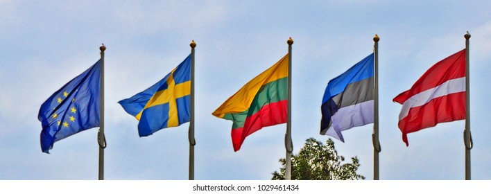 The national flags of the Baltic countries: Lithuania, Sweden, Estonia, Latvia and the flag of the European Union. National flags - symbols of independence and freedom