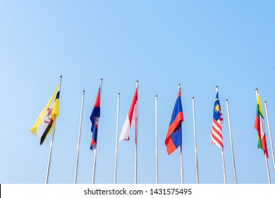 National flags different countries of Southeast Asia with blue sky background.