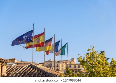 national flags of European countries (Spain, Germany, France, Italy) in spanish city Toledo