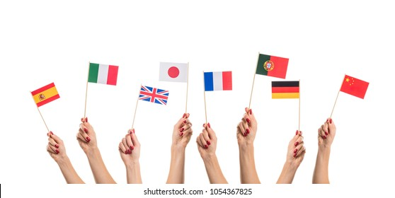 National flags of Germany, England, Italia, Japan, China Spain, France, Portugal in hands. Language studying concept on white background