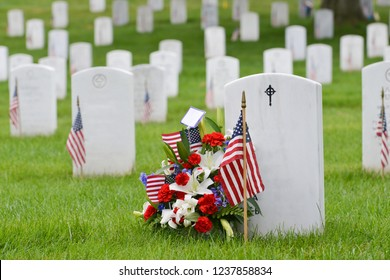 National flags and headstones in Arlington National cemetery - Washington DC, United States of America