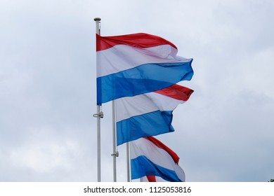 National flags of Luxembourg waving in Luxembourg city on Jun. 22, 2018.