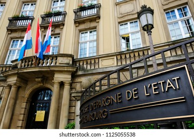 National flags of Luxembourg waving outside of headquarters of National Bank of Luxembourg in Luxembourg city on Jun. 22, 2018.