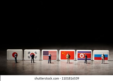 National flags with miniature men