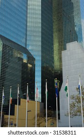 National flags and UN Headquarters building in New York