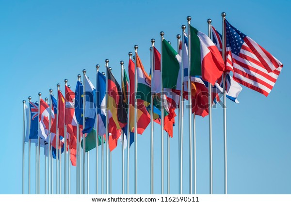 national flags of various countries flying in the wind
