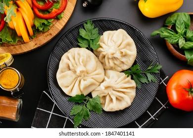 National Georgian cuisine. Khinkali with meat. Khinkali on a woo