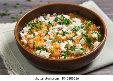National Greek dish saganaki with shrimps. Close up.