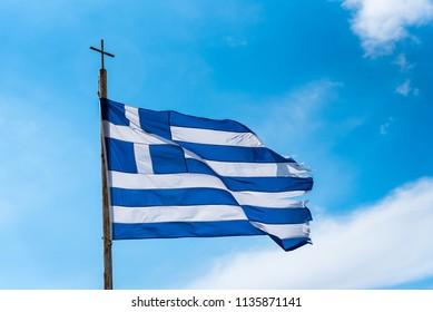 National Greek flag waving in the air.