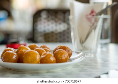 national Greek sweet pastry served in a local restaurant on a table