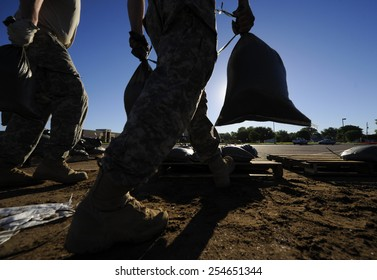 National Guard soldiers move sandbags for flood relief