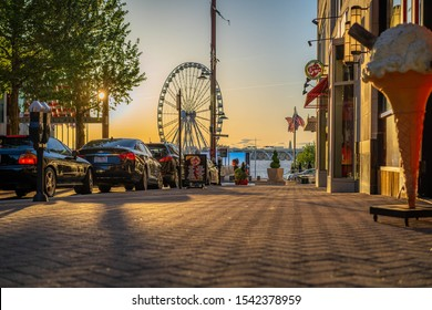 National Harbor, Maryland, United States - Summer 2019: Photo of the National Harbor in Maryland at sunset taken during Sumner of 2019.